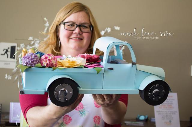 This vintage style truck, with its bed filled with flowers, was entirely created out of card stock by Sara Sherlock for the Inking Idaho on the Road event in Boise.  Fun Stampers Journey card stock, dies, and ink were used to create this showcase decor piece.