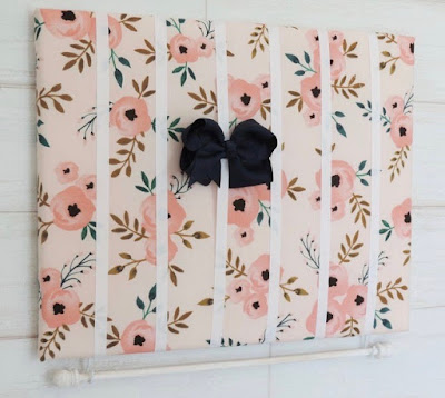 bow and headband holder — ribbons on a flower-patterned fabric backing
