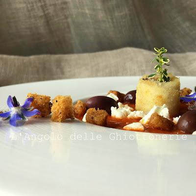 rollé di spigola saganaki, con salsa al pomodoro pachino e peperone rosso arrostito