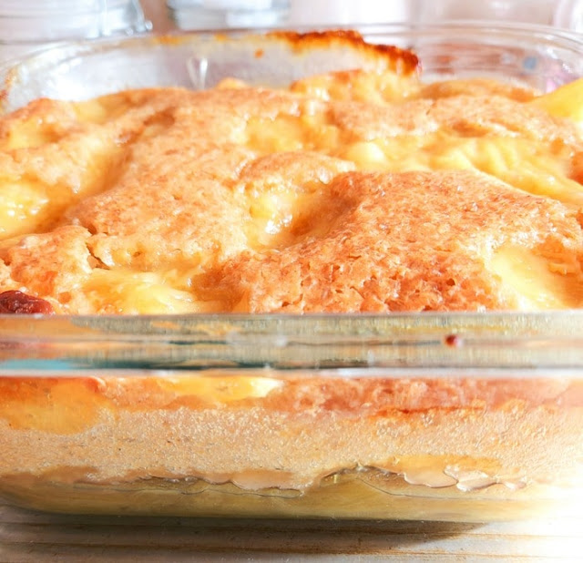 Baked rhubarb & custard pudding in a glass Pyrex dish