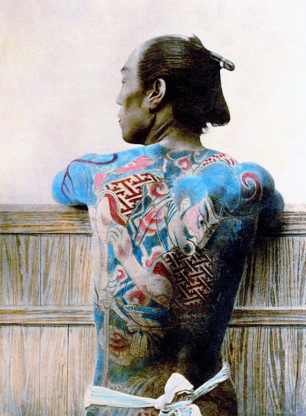 A tattooed man's back, c. 1875.
