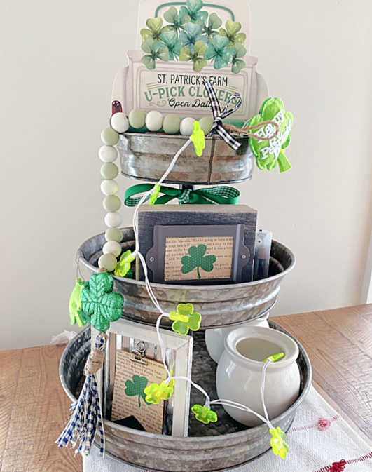 tiered tray filled with St. Patrick's Day decor