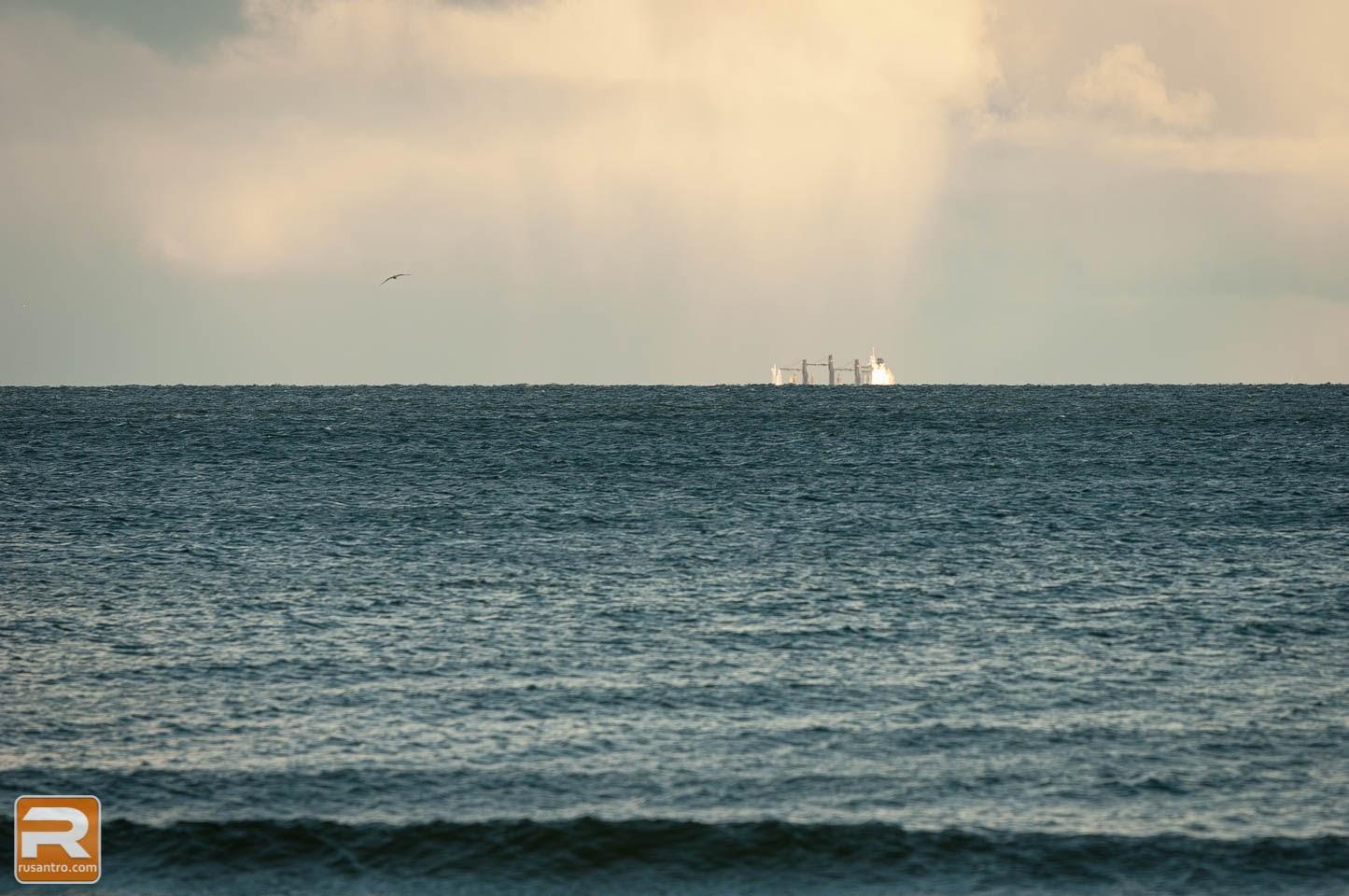 Kuģis aiz jūras horizonta
