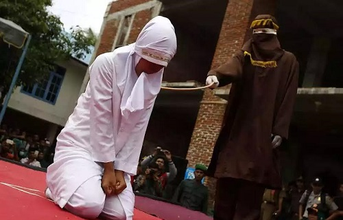 Woman, Two Men Flogged In Public For Adultery In Indonesia (Photos)
