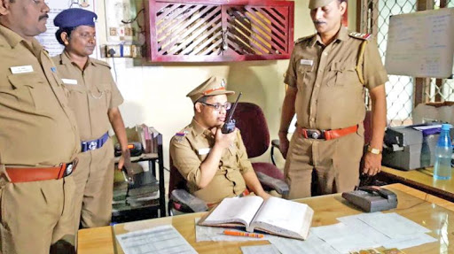 Downs syndrome boy with Indian policemen