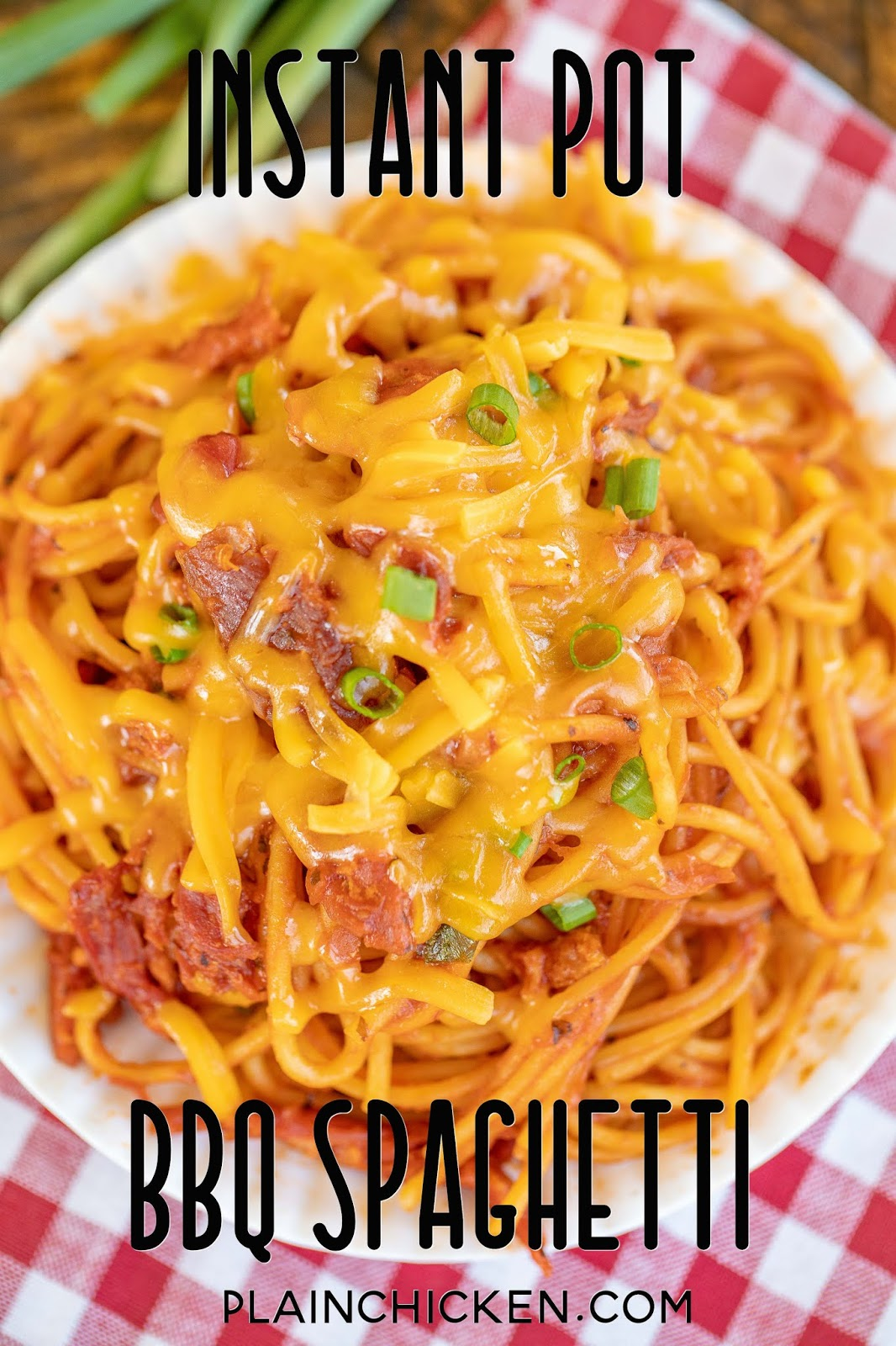BBQ spaghetti topped with cheese and green onions