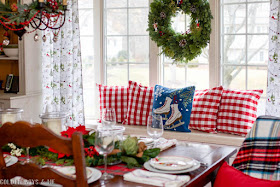 Dining room window seat with Wayfair embroidered ice skates pillow