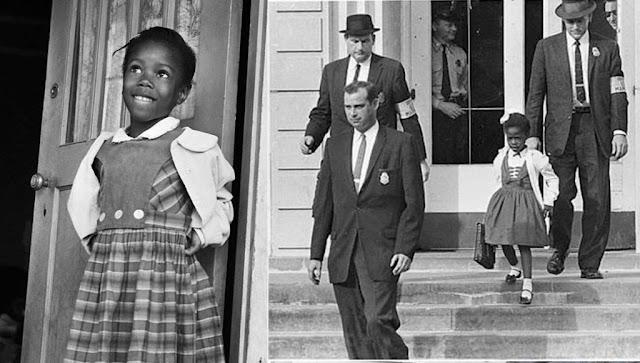 Ruby Bridges em sua fotografia iconica sendo escoltada por 4 agentes federais