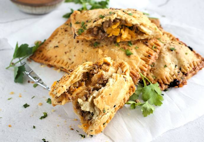 Recipe for cheesy beef filling baked inside flaky, savory homemade pastry.