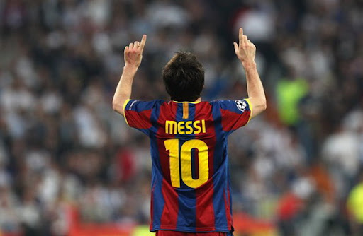 Lionel Messi celebrates after scoring against Real Madrid in the Champions League semi-final