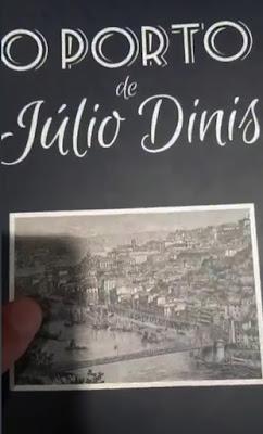 mão segurando o livro o Porto de Julio Diniz