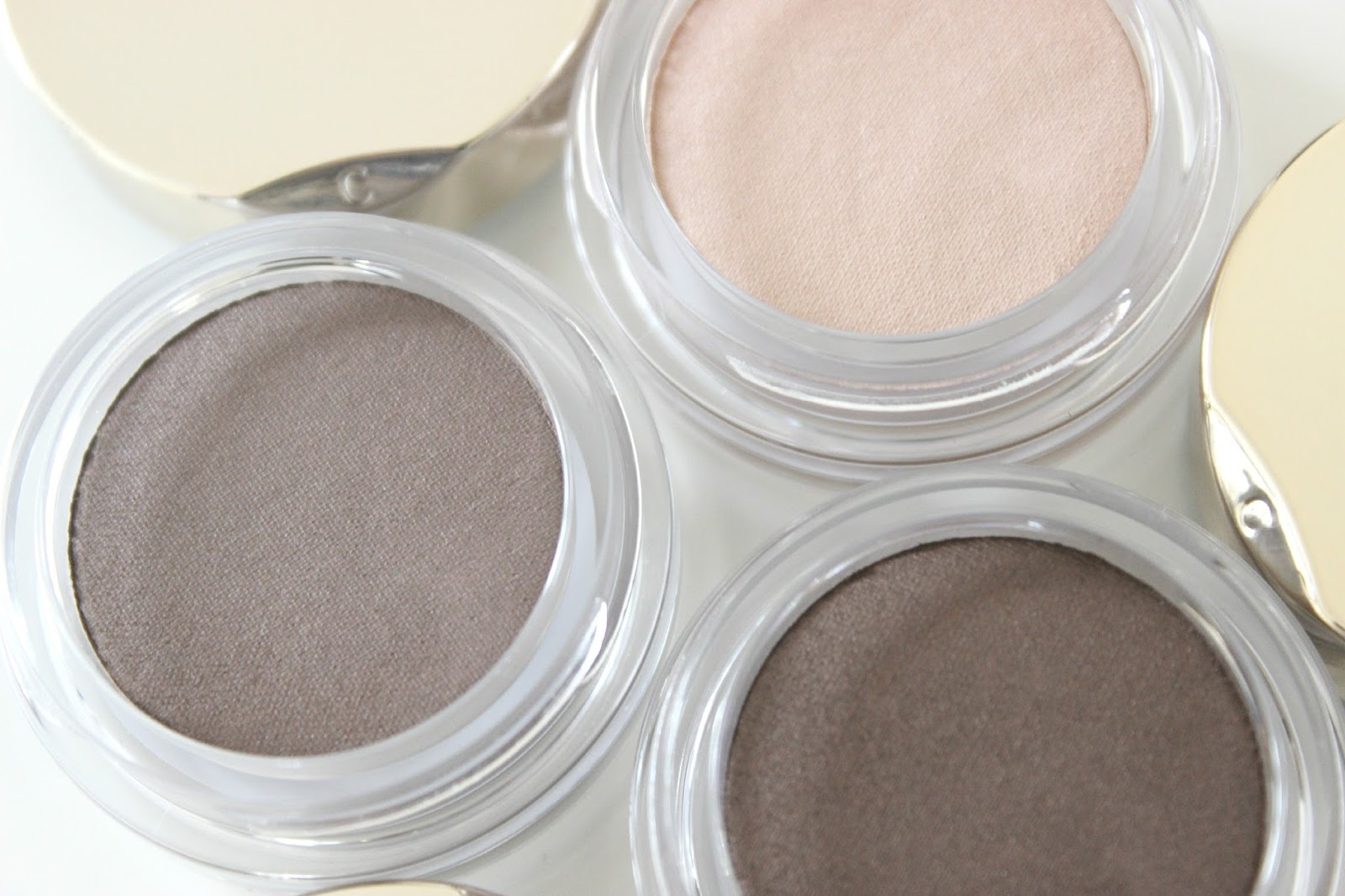 A picture of Clarins Ombre Matte Cream-to-Powder Eyeshadow in Nude Pink, Rosewood and Earth