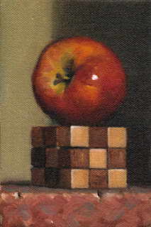 Still life oil painting of a red apple on a wooden cube puzzle.