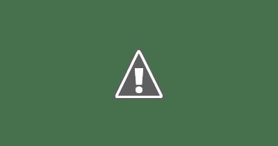 Fotografía de la mano de una persona mayor temblando al coger un vaso de agua