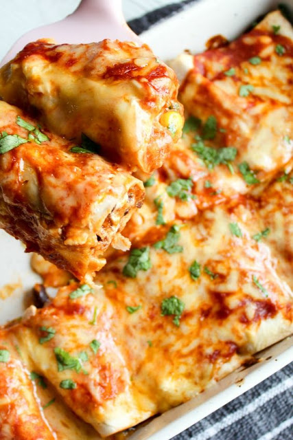 My kids go crazy for these!! Healthy , Clean Eating Chicken enchiladas with black beans and corn.