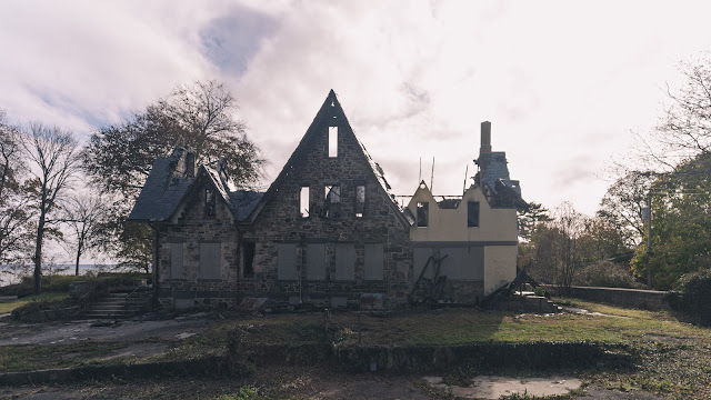 side view of arson damage mansion