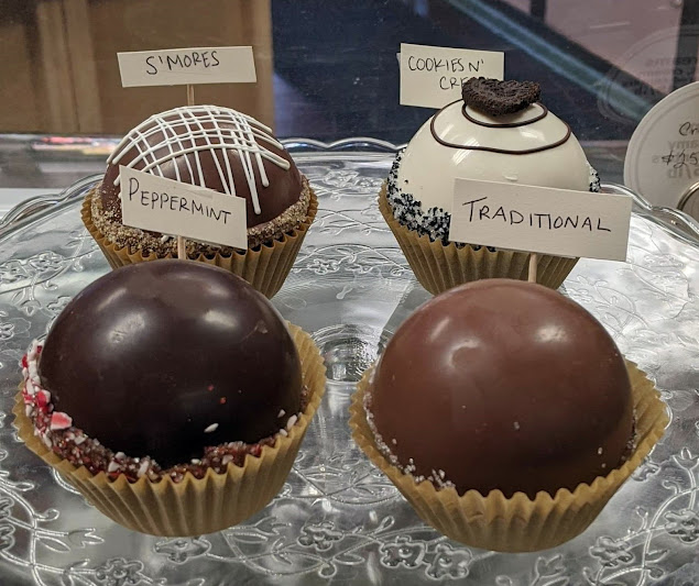 A range of tempting Hot Chocolate Balls by Louisa's and Millie's.