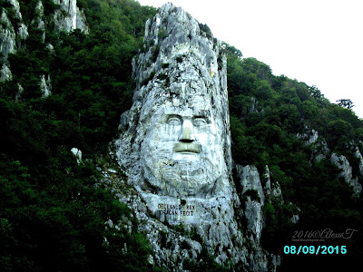 """The rock sculpture of Decebalus"".""The sculpture was made between 1994 and 2004, on a rocky outcrop on the river Danube, at the Iron Gates, which form the border between Romania and Serbia. It is located near the city of Orșova in Romania. It is the tallest rock sculpture in Europe."" ""Locul realizării sculpturii este în apropiere de orașul Orșova, în zona cataractelor de la Cazanele Mici (golful Mraconia), pe malul stâng al Dunării, acolo unde adâncimea fluviului este cea mai mare: 120 de metri."" excerpts wikipedia"