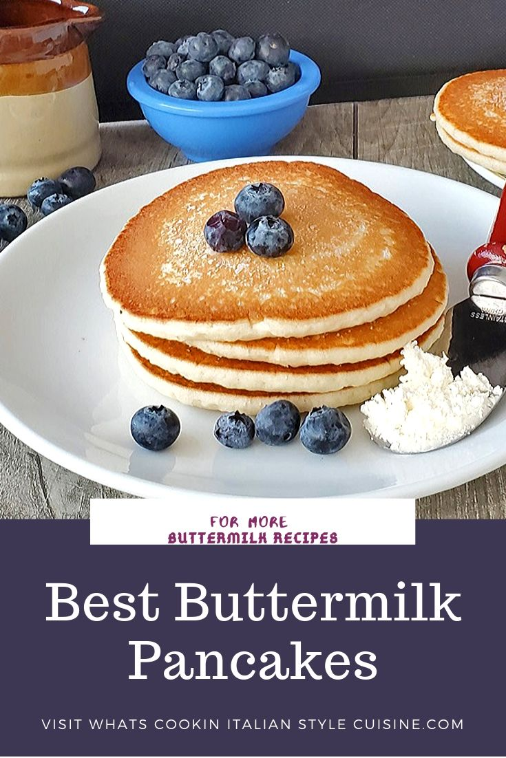 this is a pin for later stack of buttermilk pancakes with blueberries on top, butter on the side of the white dish syrup in the background with more blueberries in a blue bowl