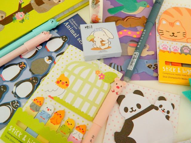 a photo showing lots of cute sticky notes, stationery and pens.