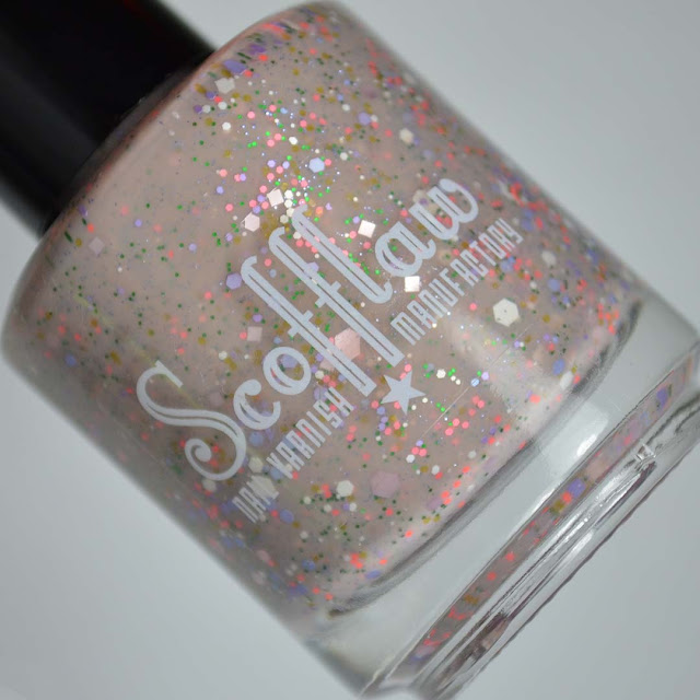 nude nail polish with 60's inspired glitter mix in a bottle