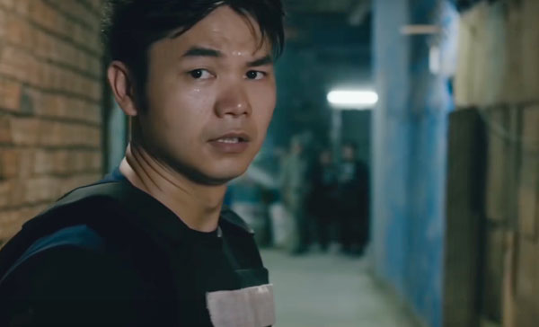 Jean-Paul Ly plays one of the cops in JAILBREAK (2017)