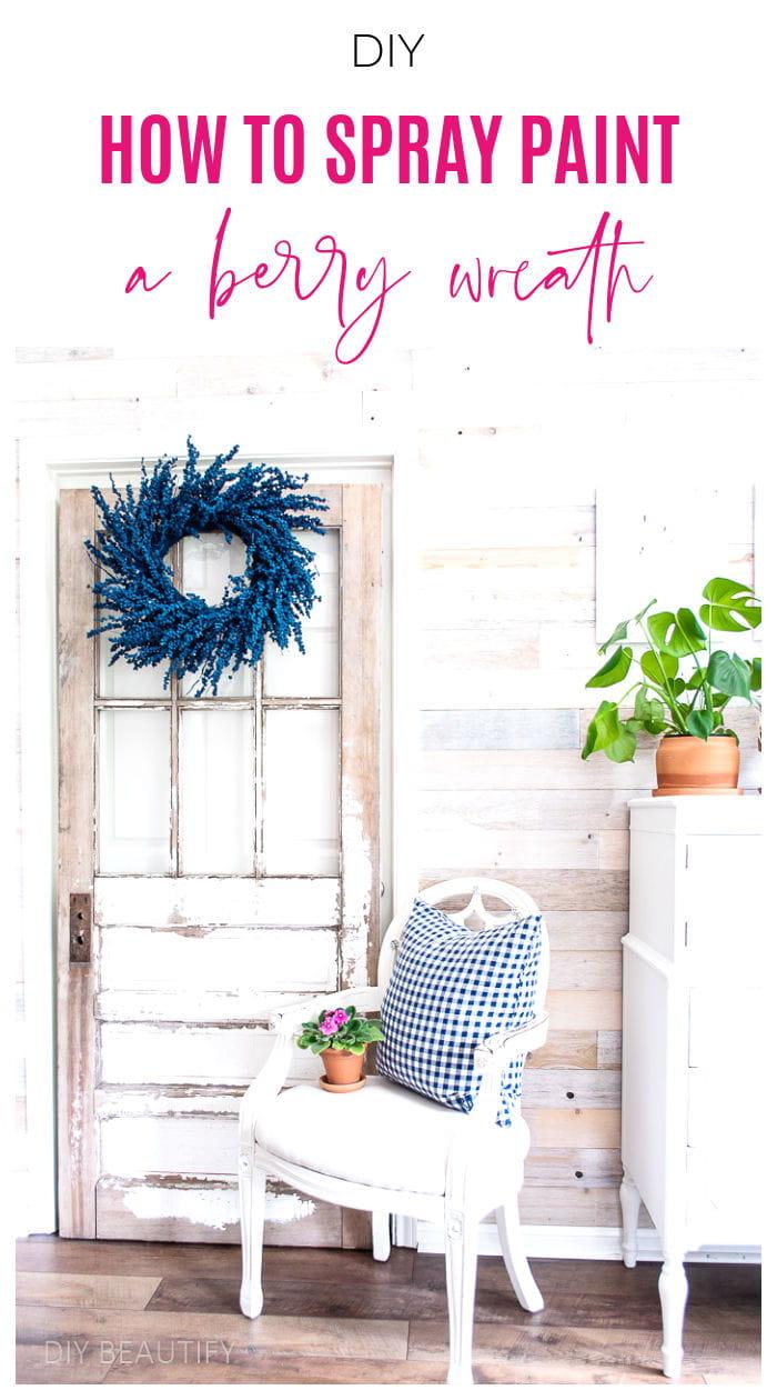 blue berry wreath hung on vintage door in sunroom
