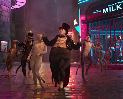 "Bustopher Jones (James Corden), Victoria (Francesca Hayward), and many other Jellicle Cats dance through London in one of the worst movies of 2019, ""Cats."""