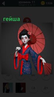 Поз зонтиком и в национальной одежде гейша с веером