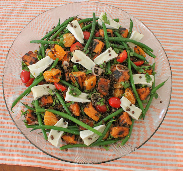 "Food Lust People Love: When you want to lighten up your menu for the holidays, this salade composée of ""roasted"" sweet potatoes, lentils and French beans, dressed with a shallot vinaigrette, Mandarin oranges and cilantro is perfect. Festively colored and full of flavor, it's substantial enough to be a main course, or serve smaller portions as a starter or side dish."