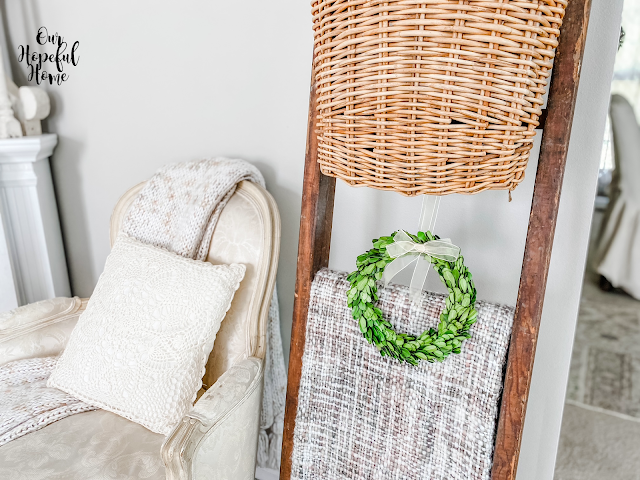 small hanging boxwood wreath blanket ladder woven throw