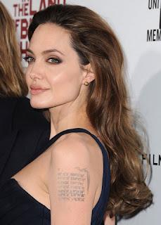 Angelina Jolie removed tattoos