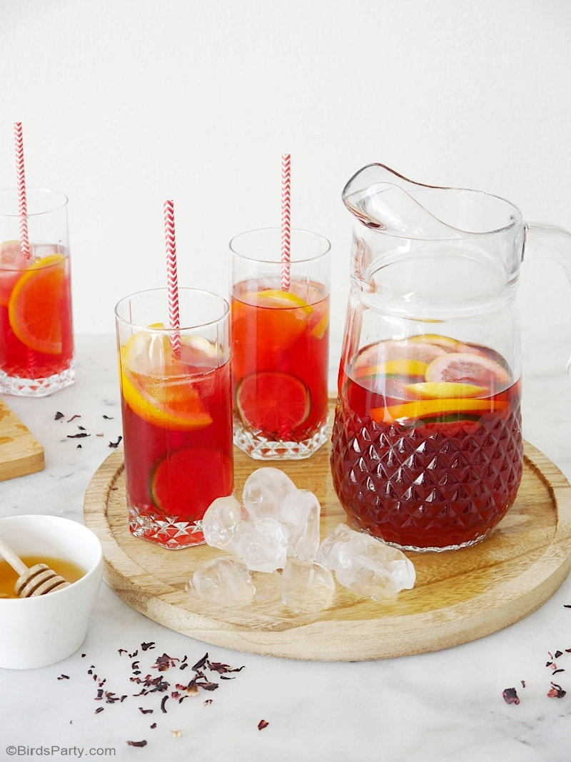 Hibiscus Iced Tea Recipe - quick, easy and delicious drink for summer or for your 4th of July party! by BirdsParty.com @birdsparty #hibiscus #recipe #icedtea #summerdrink #summerrecipe #hibiscusrecipe #hibiscusicedtea #hibiscustea #4thofjuly #drinks #beverages
