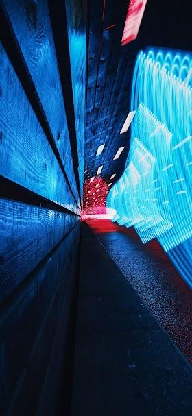 خلفية تشكيلات ضوئية زرقاء داخل نفق أزرق