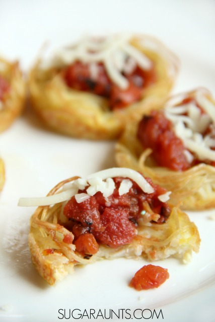 Spaghetti Cups Recipe Cooking with Kids recipe that kids will love! Load these spaghetti cups with vegetables for a creative snack, appetizer, or main dish that uses leftover pasta or cooked spaghetti.  This is a unique and fresh muffin tin recipe for families that can be filled with your kids' tastes!