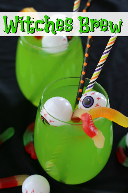Green punch in clear glass with plastic eyeballs and gummy worms