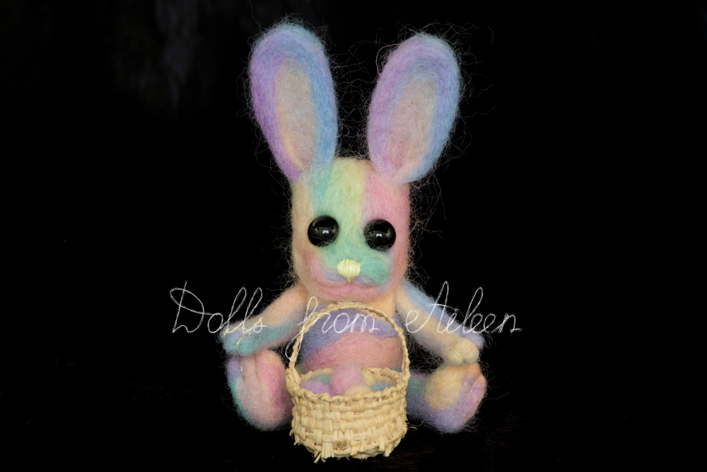 ooak needle felted Easter bunny sitting with basket of eggs