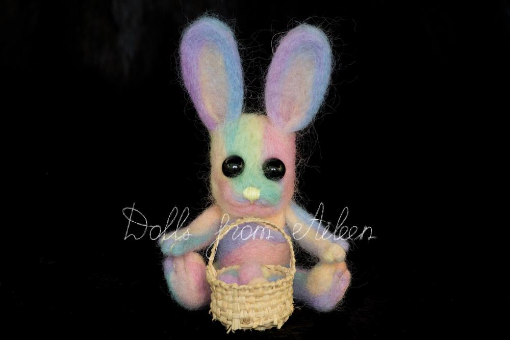ooak needle felted Easter bunny sitting with basket of eggs