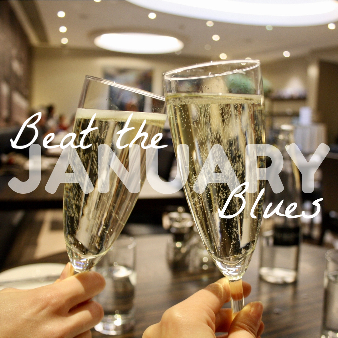 saying cheers with two glasses of Prosecco, with the words beat the January blues superimposed on top