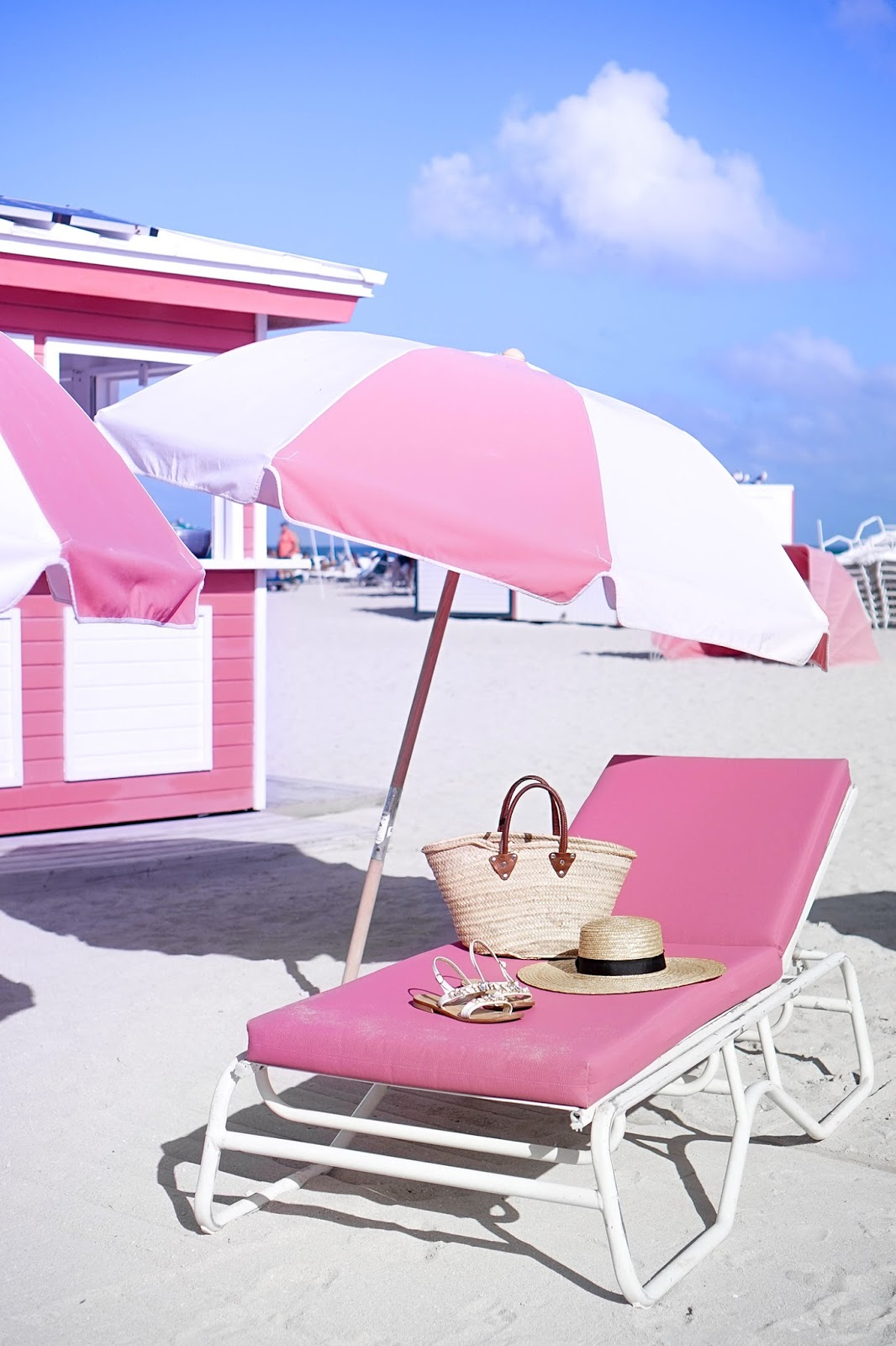 pink beach chair hanging pier one canada bum what s better than spending a day relaxing on the in miami lounge with striped umbrellas