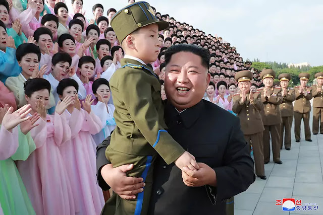 Kim Jong Un with members of art groups of KPA officers' wives, June 4, 2019