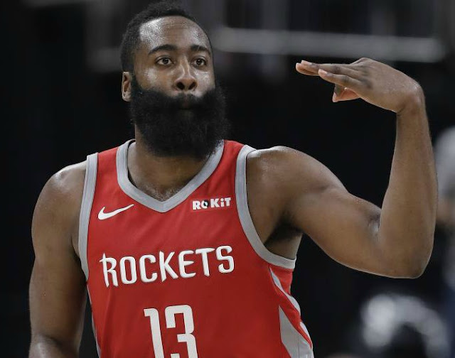 James Harden playing basketball with his team
