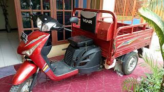 Motor roda tiga