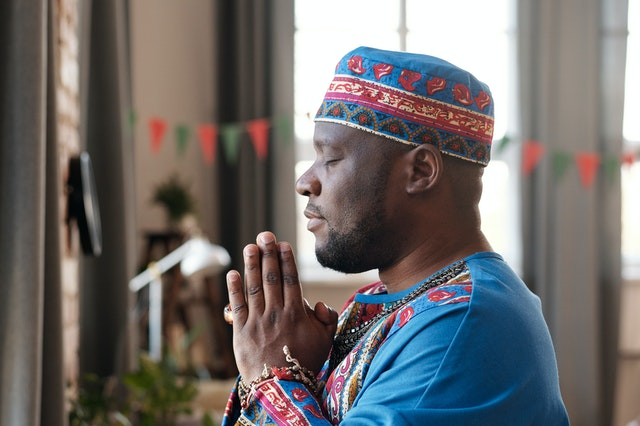 Man standing in a prayer posture