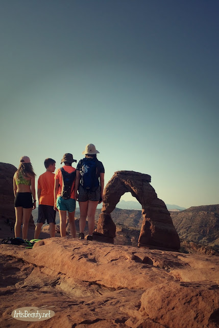 my family hiking up to delicate arch moab utah arches national park nps