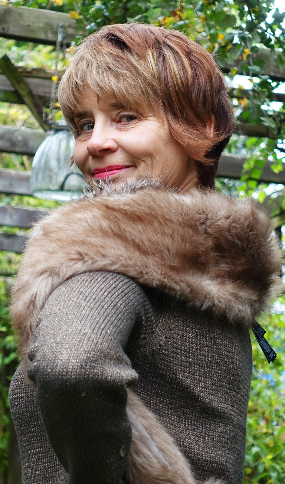 Imageshowing Gail Hanlon from over-40s-blog-Is-This-Mutton in thrifted corduroy coat and vintage wardrobe items including a fur stole