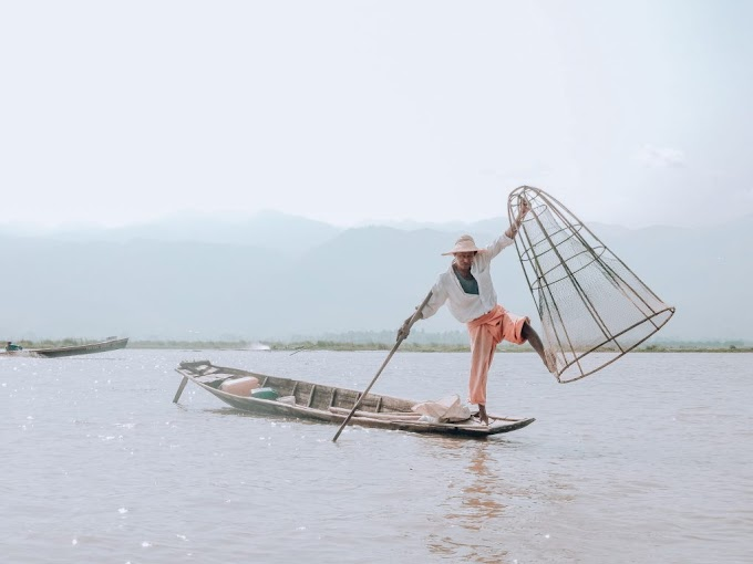 People Rowing with Leg and Float Village in Inle Lake