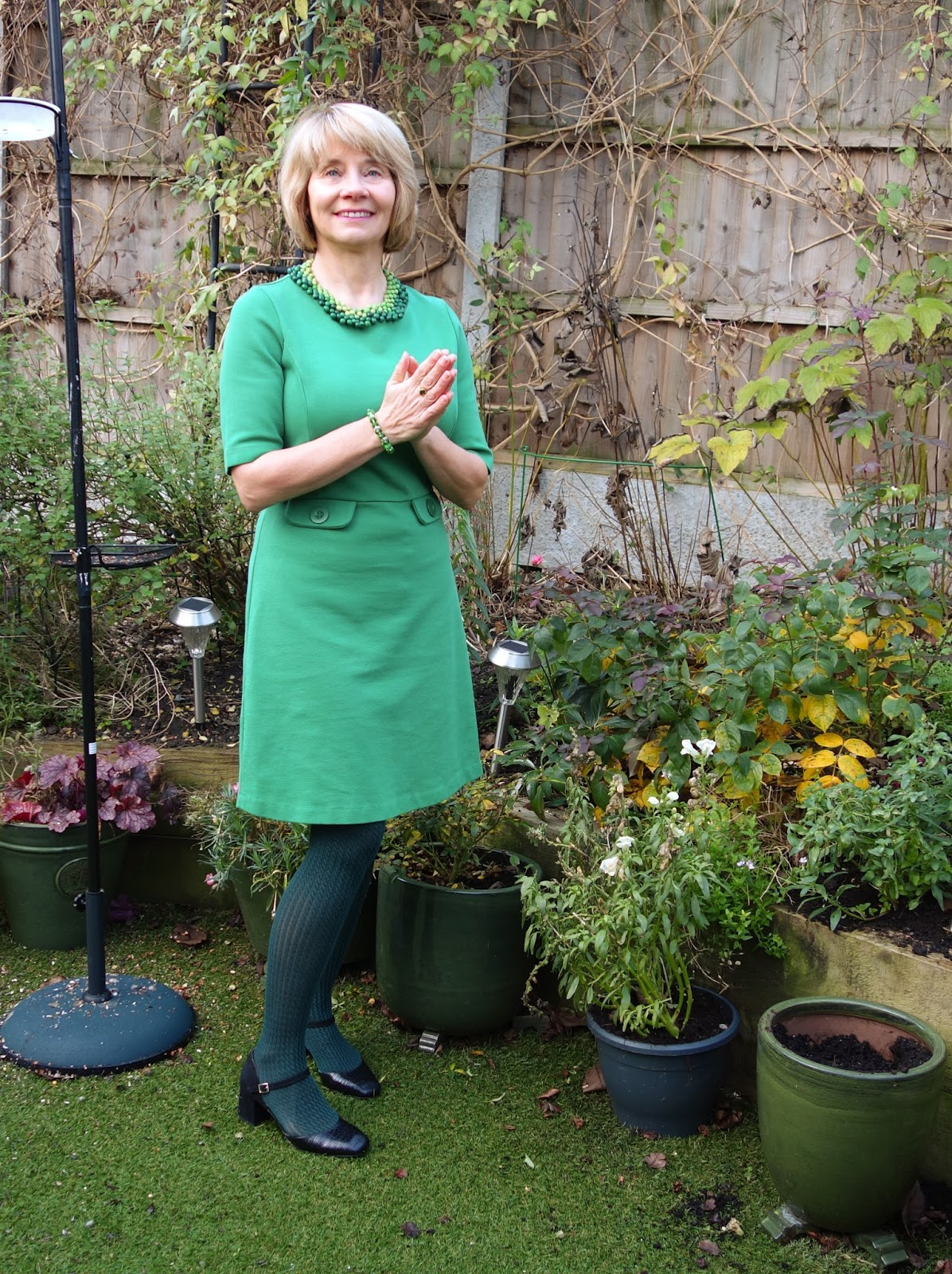 Green Boden dress worn with dark green patterned tights