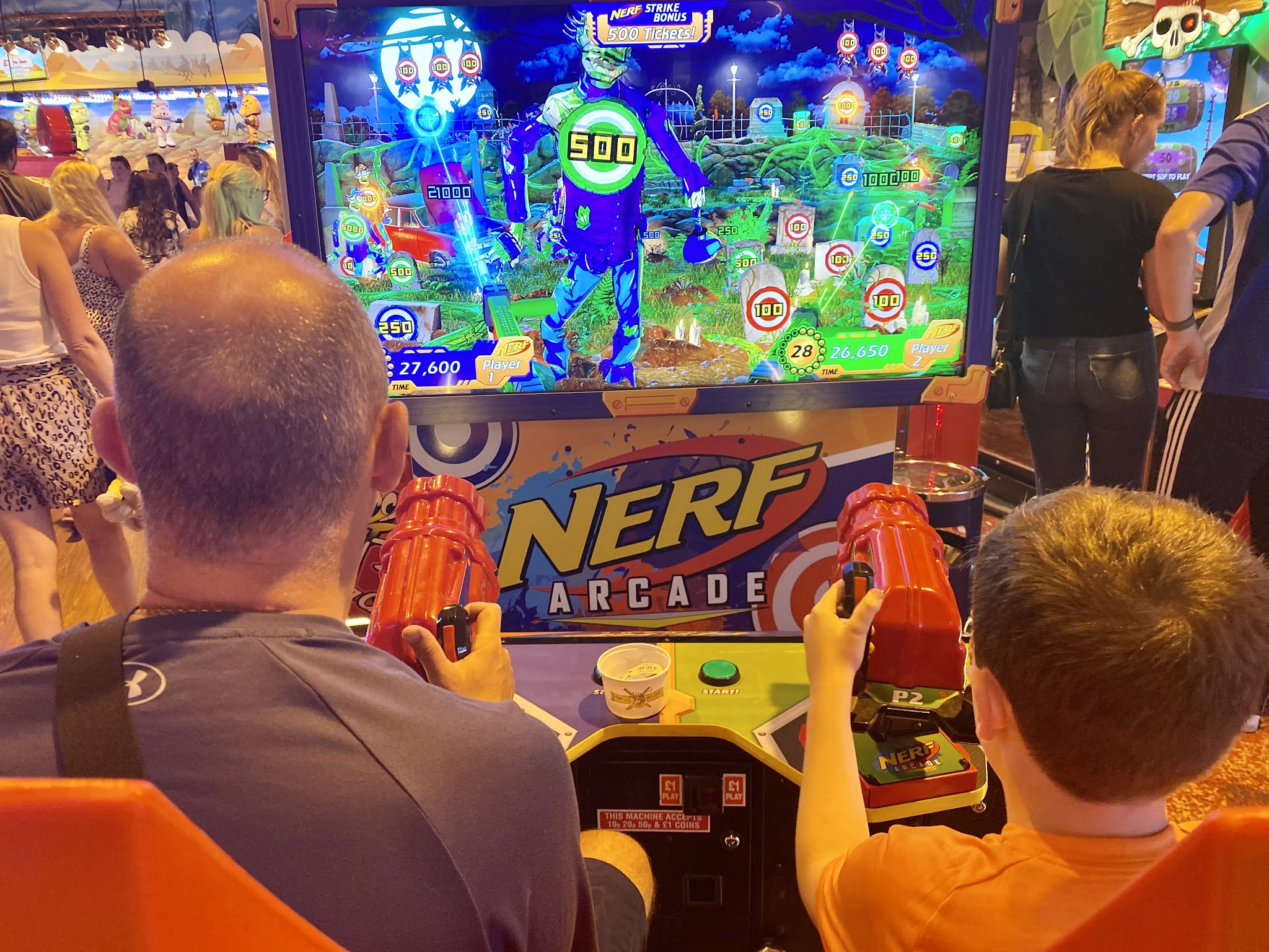 playing Nerf game in arcade