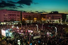 Montenegrins took to the streets of  Montenegro city capital protesting and demanding the resignation of President Djukanovic .